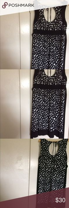 "‼️ FLASH SALE ‼️Connected Apparel dress. Cute Connected Apparel Black and White Sleeveless Dress. The dress has a v neck, peek a boo back with a tie. There is also a belt tie in the back. There is black trim around the sleeves, waist and hem.   Lying flat measurements: Bust: 18"" Waist: 17"" Length: 37""  Self:  94% Polyester     6% Spandex   Contrast: 96% Polyester     4% Spandex  Lining: 100% Polyester   No stains or tears   Offers welcome   Thanks for coming by. Connected Apparel Dresses…"