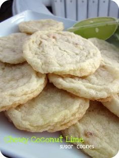 Chewy Coconut Lime Sugar Cookies    2 3/4 cups all-purpose flour  1 teaspoon baking soda  ½ teaspoon baking powder  ½ teaspoon salt  1 cup butter, softened  1 ½ cups white sugar  1 egg  ½ teaspoon vanilla extract  zest of one large lime, finely minced  3 tbsp lime juice  ½ cup unsweetened toasted coconut  ½ cup sugar for rolling cookies