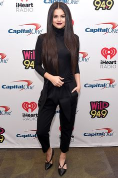 In a tight knit JOE's black turtleneck and black AYR harem pants at Jingle Ball 2015 in California. - HarpersBAZAAR.com