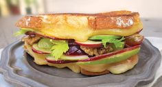 The Waldorf: All the flavors of the classic, tangy Waldorf salad are captured between slices of gooey, grilled Wisconsin Gouda on chewy sourdough bread. A modern twist on a retro classic, this sandwich is sure to please the most sophisticated of taste buds.