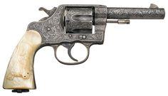 Pearl-handled Colt Service Revolver.