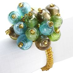 Peacock Party...Beaded Napkin Rings the Colors let you mix & match different hues of napkins & placemats rather than all the same!