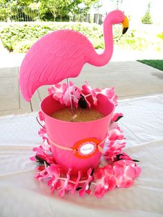 Flamingo in a bucket.  Figure out a way to attach the flamingo to the bottom of the bucket and use the bucket as a punch bowl with blue green punch. :)