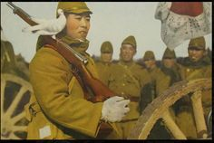 japanese soldier with a white bird on his arisaka rifle