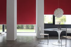 Our blackout Roller Shades are available in 70+ show stopping colors. Shown in material Bond, color Red. | The Shade Store