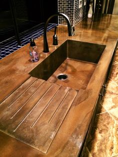 Concrete kitchen sink with drain board. Visit NuConcrete.com for all Concrete_Design & Installation.