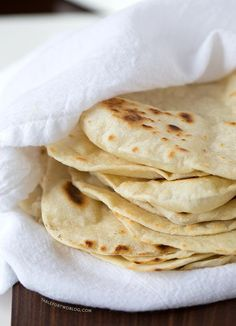 Homemade Flour Tortillas are way better than store-bought and so easy to make. Recipe on tablefortwoblog.com