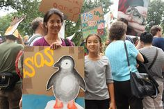 """Protest climate change people Wild Bird Fund - Janice Kambara and daughter  """"We just want to raise awareness for the destruction of habitats,"""" Janice Kambara told TreeHugger. """"Hopefully people who don't take these issues seriously will read about it and change their behavior."""""""