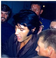 Elvis signing autographs at the International Hotel, 1969