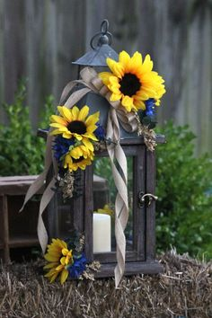 Blue Wedding Flowers Yellow sunflowers and Navy blue centerpieces - Can't get enough Sunflower Wedding Centerpieces, Lantern Centerpieces, Rustic Wedding Centerpieces, Wedding Flowers, Candle Lanterns, Wedding Rustic, Centerpiece Ideas, Fall Sunflower Weddings, Blue Sunflower Wedding