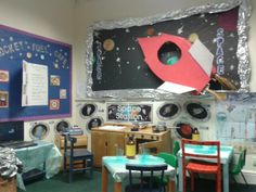 Our nursery role play Rocket Fuel Cafe with a till, tables to serve and pads for taking orders for writing.