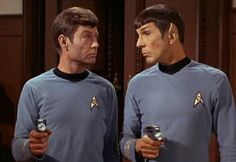 It sure looks like Spock and McCoy are having a silent argument about whether these phasers are logical or not.