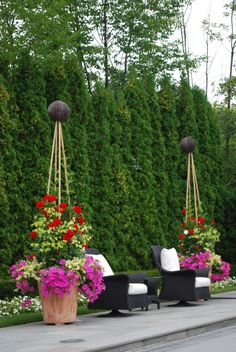 gorgeous planters - what are those at the top of the tripods?
