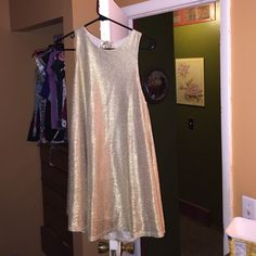 Shimmery gold sleeveless dress! Gold dress, worn once beautiful dress! Open back for a flirty look, but very elegant at the same time! Pairs great with most heels and wedges! Dresses Mini