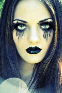 Make-up. Black feather eyelashes. Liquid eyeliner pen for detail, maybe gel eyeliner under eyes and use eyeshadow or smudge to get black under eye.