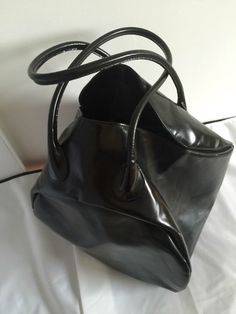 A personal favorite from my Etsy shop https://www.etsy.com/listing/286425027/comme-des-garcons-leather-handbag-rare