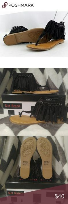 Black Fringe Sandals Pamper your feet with trendy, retro styles influenced by the sparkle of pop culture. Evoke your inner artist, idol, or rock star diva.  Put your boho-chic side on display this season with the Not Rated King Maker sandal!  Man-made upper. Back zippered closure. Open toe. Thong-style silhouette. Fringe and metal link details along collar. Man-made upper. Lightly padded footbed. Rubber outsole. Imported. Not Rated Shoes Sandals