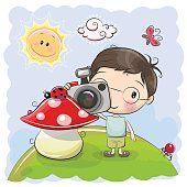 Menino bonito dos desenhos animados com a câmera
