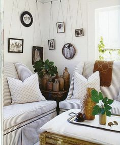 Along dining room back wall? Notice how the accessories give character to this space- hanging photos, vintage jugs. Hanging Picture Frames, Hanging Photos, Picture Ledge, Picture Hangers, Cottage Living, My Living Room, Cottage Style, Flea Market Decorating, Decorating Ideas