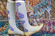 Brenna rocks Ozone's Lacey Faux Lace Up Knee Socks over purple color tights! These are such a unique luxury sock - I've never met a more durable sheer! UPDATE: we regret to inform you that this style has been discontinued and is no longer available.