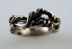 An original band ring, inspired by the movement of water and wind, carved in wax and cast into sterling silver in the traditional lost wax