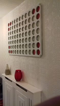 Contemporary hand-made wall art, as an alternative could be used as a family photo display.
