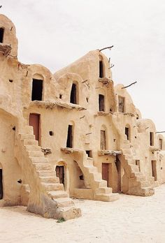 Berber Grain Storage Houses in the form of vaulted adobe buildings in the city of Tataouine in South Tunisia (famously known from the original Star Wars Movies) / photographed by Alex Erkiletian . Oh The Places You'll Go, Places To Visit, Vernacular Architecture, North Africa, Historical Sites, Travel Inspiration, Design Inspiration, The Good Place, Beautiful Places