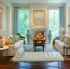 love the colors one straight panel on each window in between fireplace... Kahn Design Group Old Naples Residence