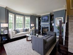 Dark floors, distinctive blue walls and white trim contrast beautifully. New homes by Integrity Homes in National Harbor, MD. Dark Blue Rooms, Blue Walls, Classy Living Room, Pretty Room, French Farmhouse, Condos For Sale, Room Accessories, Old Houses, Great Rooms