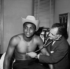 Muhammad Ali 1967, receiving a check-up from Dr. Harry Kleinman at the New York Athletic Commission in New York City. John Lindsay.