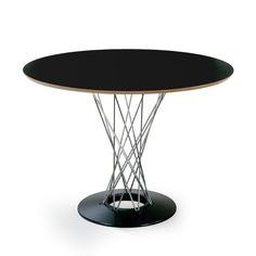 Isamu Noguchi Cyclone Dining Table With an eye-catching wire silhouette and…