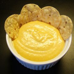 This is a vegan version of the melted nacho cheese dip that you might get at a movie theater or other event, often served with corn chips and jalapenos. It is a winner with kids, and I like to serve it with enchiladas and chili potatoes.