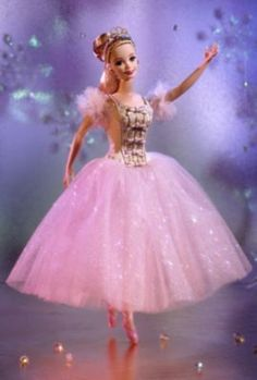 Barbie® as the Sugar Plum Fairy. A truly lovely doll begins the Classic Ballet Series™, featuring dolls dressed in costumes from the world's most beloved ballets. From Tchaikovsky's Nutcracker comes Barbie® as the Sugar Plum Fairy, whose costume is a delicate work of art with its skirt in several shimmering layers of light pink tulle. An ivory bodice is trimmed in golden ribbons and bows. She wears sheer ivory tights and pink ballet slippers with lace-up ribbons.