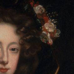 Willem Wissing: Rttratto di Elisabet Jones, contessa di Kildore. Olio su tela del 1648. Yale Center for Brtish Art, New Haven, USA. Da sotto il cappello nero che si confonde con il fondo scuro escono voluminosi i boccoli castani e spiccano ancora di più i fiori che ornano il cappello.