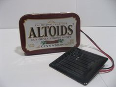 Solar Charger! Oh yeah ... http://www.treehugger.com/clean-technology/make-a-cheap-easy-solar-usb-charger-with-an-altoids-tin.html