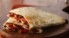 Wrap up these tasty quesadillas for dinner filled with pork mixture, veggies and cheese. Perfect if you love Mexican cuisine.