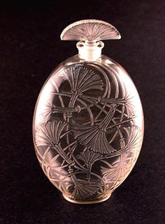 "Tantot (""In a little while"") Type: Perfume bottle  Material(s): Glass Designer/Maker: Rene Lalique for Rene Lalique et Cie.   Markings:  Molded ""R.LALIQUE"" & acid etched ""FRANCE""   Origin:  France   Date or Era:  Introduced 1925"