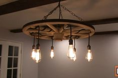 DIY Wagon Wheel Chandelier : 5 Steps (with Pictures) - Instructables Wagon Wheel Chandelier Diy, Solar Light Chandelier, Outdoor Chandelier, Rustic Chandelier, Chandelier Ideas, Chandeliers, Cabin Lighting, Rustic Lighting, Home Lighting