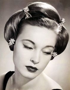 vintagetwists:    Diamonds in her hair, 1953.