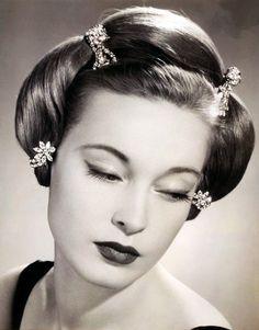 vintagetwists:    Diamonds in her hair, 1953.