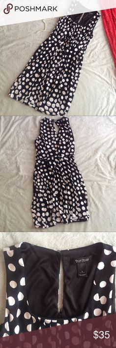 White House Black Market Polka Dot Bubble Dress Great used condition. Bubble dress by White House Black Market in black with bold white polka dots. Slight empire waist with pleated seams for a flattering fit. Back zipper closure. Lined. Note: the polka dot print doesn't line up exactly, but the pleating makes it hard to notice while on. Adorable dress for the office or an event. Size 4, see photos for measurements. White House Black Market Dresses