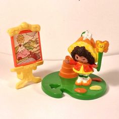http://www.ebay.com/itm/1980-S-MINI-STRAWBERRY-SHORTCAKE-ORANGE-BLOSSOM-PAINTN-AT-EASEL-WITH-MARMALADE-/162132074856?hash=item25bfd32168:g:2H4AAOSwyKxXgkmv
