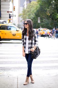 Kat Tanita of With Love From Kat wears 7 For All Mankind skinny luxe slim illusion blue jeans with a J.Crew plaid button down and Joie booties.