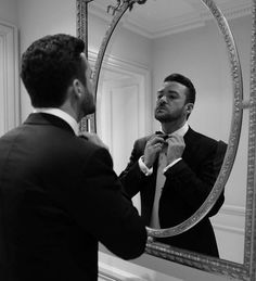 Justin Timberlake fixes his tie before heading out to the Festival de Cannes opening ceremony