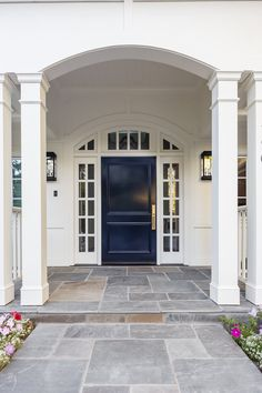 30 Modern Exterior Paint Colors For Houses. Beautiful navy blue door with side lights. Choosing the right exterior paint colors is an extremely important decision that you will have to make if you are building your own house. Exterior Paint Colors For House, Paint Colors For Home, Door Design, House Design, Porch Kits, Building A Porch, House With Porch, Modern Exterior, Ranch Exterior