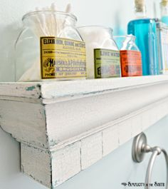 A little Mod Podge, a few spice jars, printable labels, and you've got yourself some cute vintage-looking jars to accessorize your bathroom.
