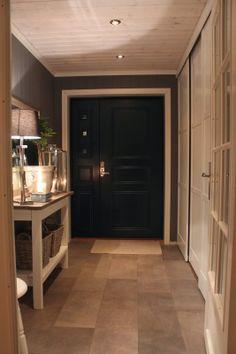 neutral colors. black front door, french doors