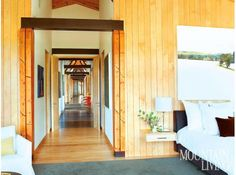Jackson, Wyoming, mountain house, rustic house, mountain modern, vertical paneling, russian birch, bamboo ceiling, concrete floor, master bedroom ARCHITECTURE by Ward + Blake Architects PHOTO by Gibeon Photography MORE INFO at: http://www.mountainliving.com/article/new-old-west#