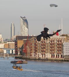 The film 'How to train your Dragon' PR stunt this morning, with the Dragon kite towed by Thames Rib Experience eventually flying under Tower Bridge!