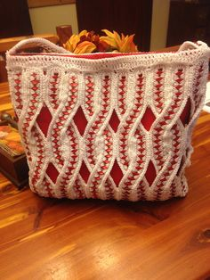 This purse is crocheted using the red pop tabs from Budweiser Beer cans. It took over 50 hrs of crochet and sewing to put it together, not to